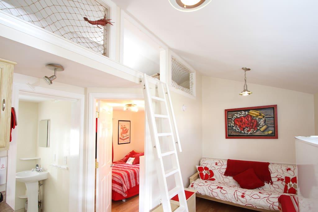 Living room area with sleeping loft