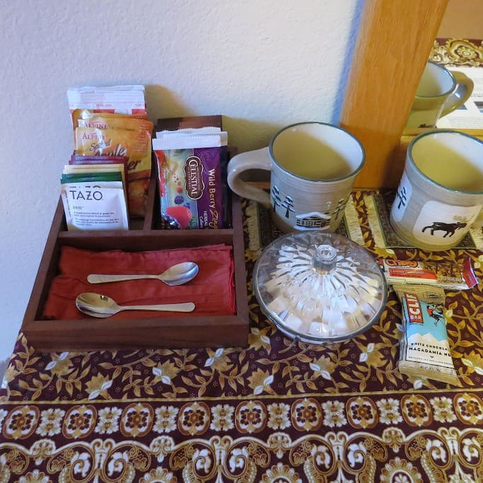 Beverage tray with an assortment of teas, coffee, hot chocolate, and apple cider.