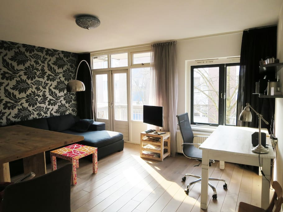 Bright livingspace attached to sunny balcony