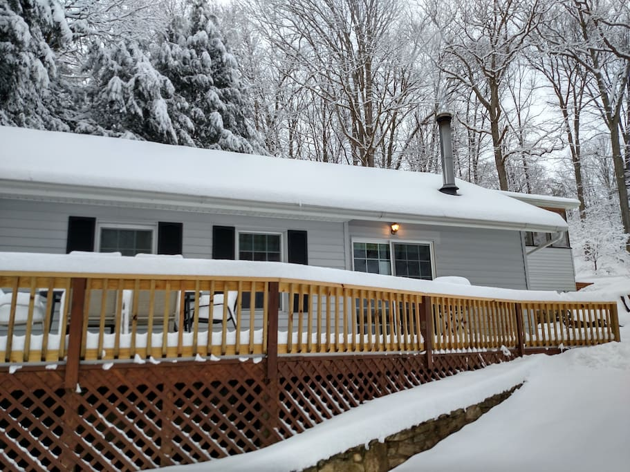 Front of cottage on snowy day in January. Cozy, warm, and peaceful.