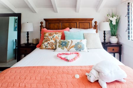 You enter the Oceanview suite from the main level into the living room, where you will find a Pun'a sofa/bed, (real twin mattress) and lanai, upstairs is the bedroom (queen size bed), you can view the ocean from your bed, kitchenette, and bathroom
