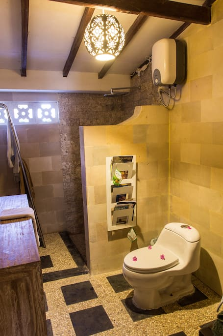 The main bathroom is spacious and well equipped, providing modern toilets, a hot water shower, and all facilities of a European sensibility and distinctiveness.