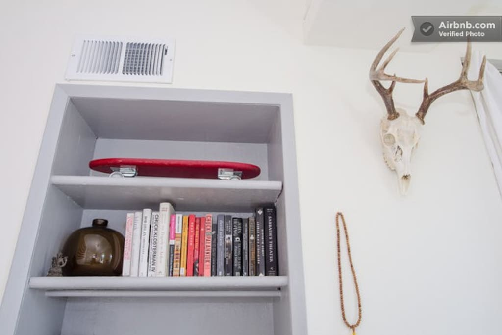 shelves with books and other cool looking things.