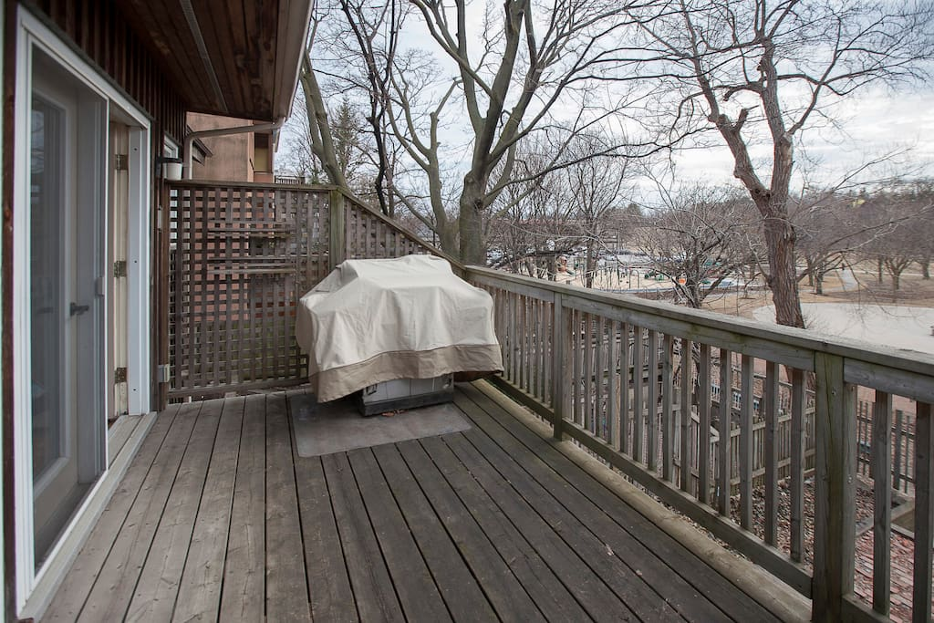 Main floor deck with barbecue overlooking Eglinton Park and new children's playground