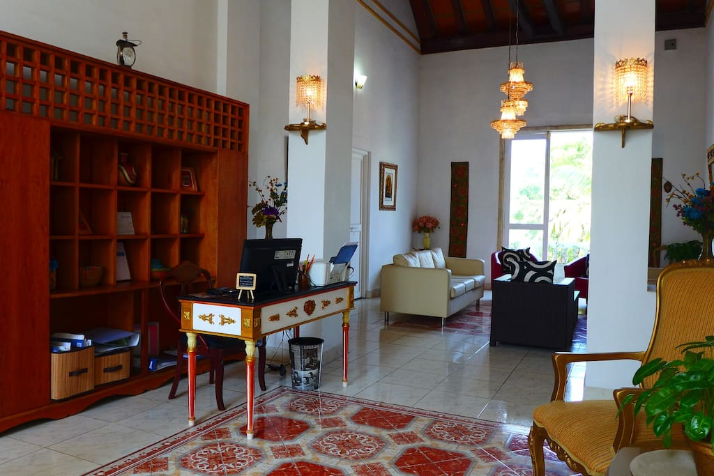 Reception & Lobby of Diego de Alcalá Suites. Check-in at reception desk with James.