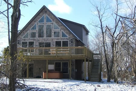 House is in a lovely private community of Lake Harmony Estates in Lake Harmony, Pennsylvania.  It is a 3 story, 2800 square foot house that has 6 bedrooms and 3 full baths. This home was constructed as the perfect vacation home. Fits 18 people