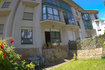 Apartment with private garden bordering BEACH - Entreplayas