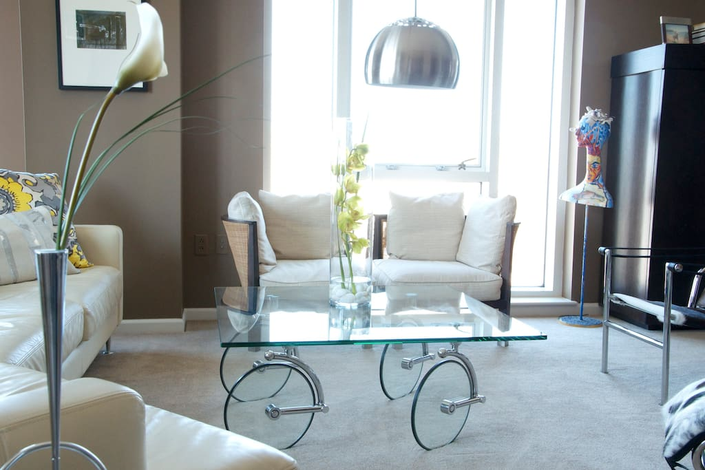 We have original art and some pretty unique furniture, like this glass table on wheels from Miami FL.