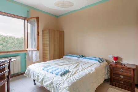 The colorfullapartment is located in a quiet area, with  green public gardens where to take walks. 15 minutes from the historic center of Perugia.  many bus stops that will take you directly in the center or at the train, or everywhere you want.