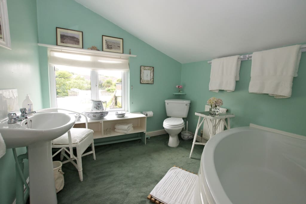 Your bathroom, spacious corner bath, large fluffy towels...space to relax.