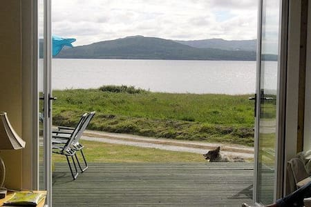 Linsfort Chalet is located in a quiet woodland area at Porthaw, Buncrana, Co. Donegal and is only 50 metres from the beach and coastal walk. The cottage has a front garden and large parking space at the back and side.Relax on the frontpatiobeachviews