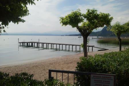 Lovely Garda avec plage privé - Appartement