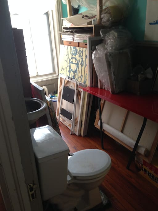 Parlor floor bathroom - toilet/sink only, accessible from office