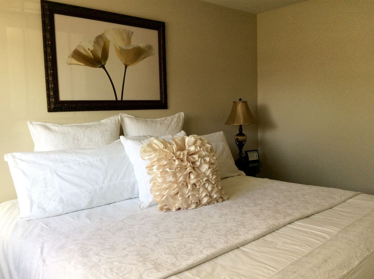 King size bed with high end white linens for special occasions!