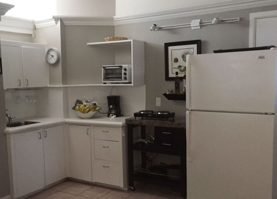 Kitchen area, has all the basic needs including a full sized refrigerator,  2 burner cooktop, coffee maker, microwave and convection / toaster oven.