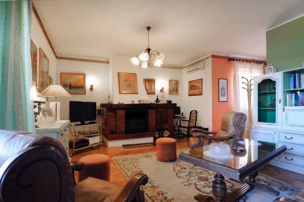 The spacious living room with the shabby schic furniture