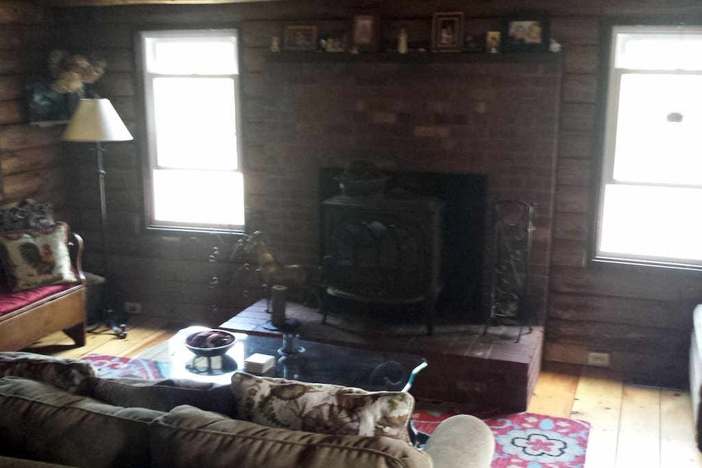 Living room is very cozy with a great woodstove.