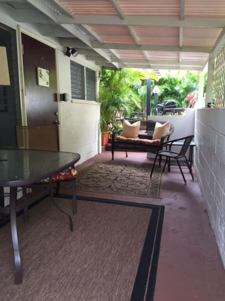 Your private entrance, with large covered lanai with full size table and chairs, small gas grill for your personal use.