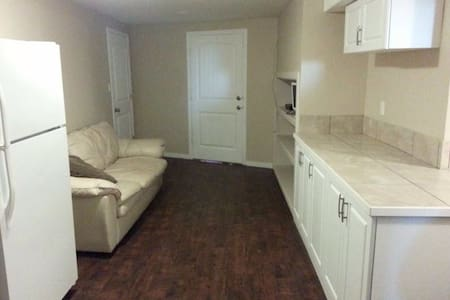 Furnished 2 bed-basement with stove