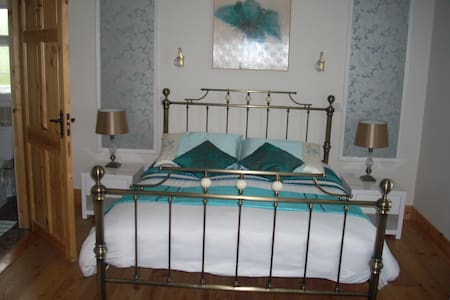 Golden Rose House is just 500 yards from Knock Shrine on private grounds offering guests a peaceful stay. En suite room,TV and complimentary tea/coffee. Knock Airport  15 mins away,Claremorris train Station 7 Miles, Bus eireann Route 64 stop nearby