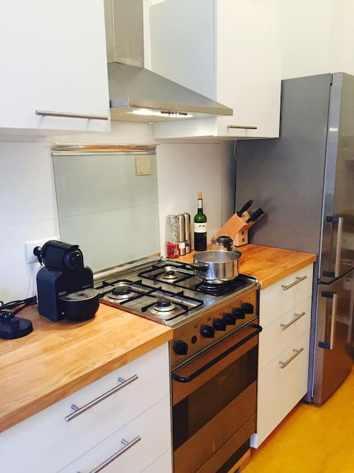 This is the kitchen with a Nespresso coffee machine.