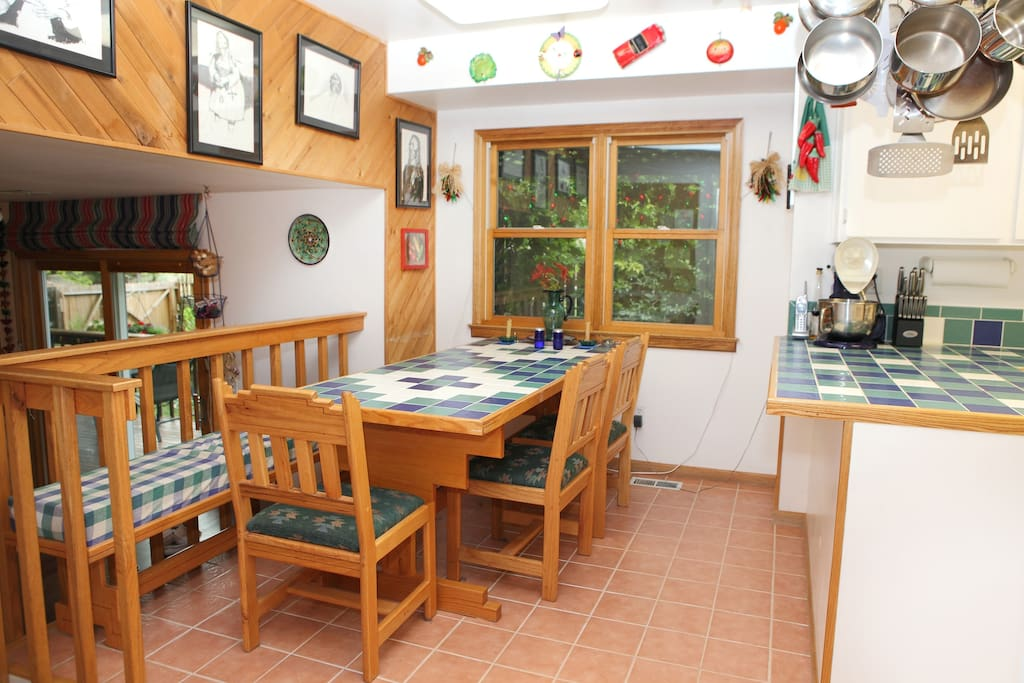Dining area in kitchen. Tiled table can be turned sideways for extra counter or serving space.