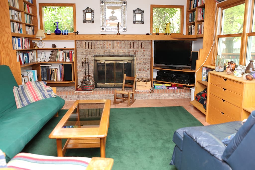 Family room with west and south facing windows. TV, DVD player, books, and board games.
