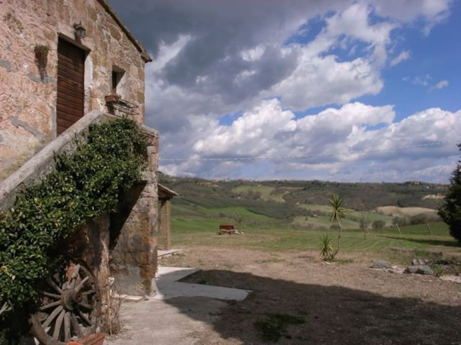 Side view of house with view of olive groves and countryside.