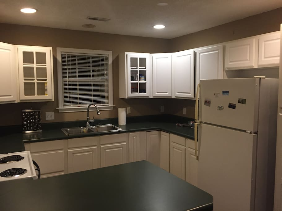 Full kitchen, fridge, etc. with standard pots, pans, and utinsels