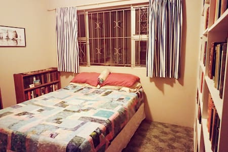This comfortable and convenient bed and bath is set within a private home in Glenwood. It comfortably sleeps two and is within walking distance of Howard College, DUT, the CBD, restaurants and attractions. During your visit enjoy the lovely patio, garden, and self-catering kitchen. The perfect stay in Durban!