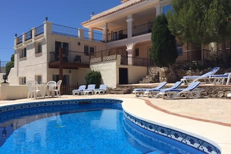 5 Bed, 3 bath villa with seperate 3 bed, 2 bath apartment, games room and private pool. Sleeps 24. This rarely found 550sqm property offers two substantial homes and has some of the best views of the Costa del Sol, Located 1.5km from Mijas village.