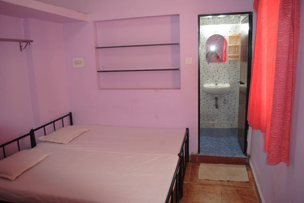 AC bedroom2 with double bed and attached washroom