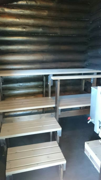 Sauna, heated by wood, also hot water heated by wood, no running water.