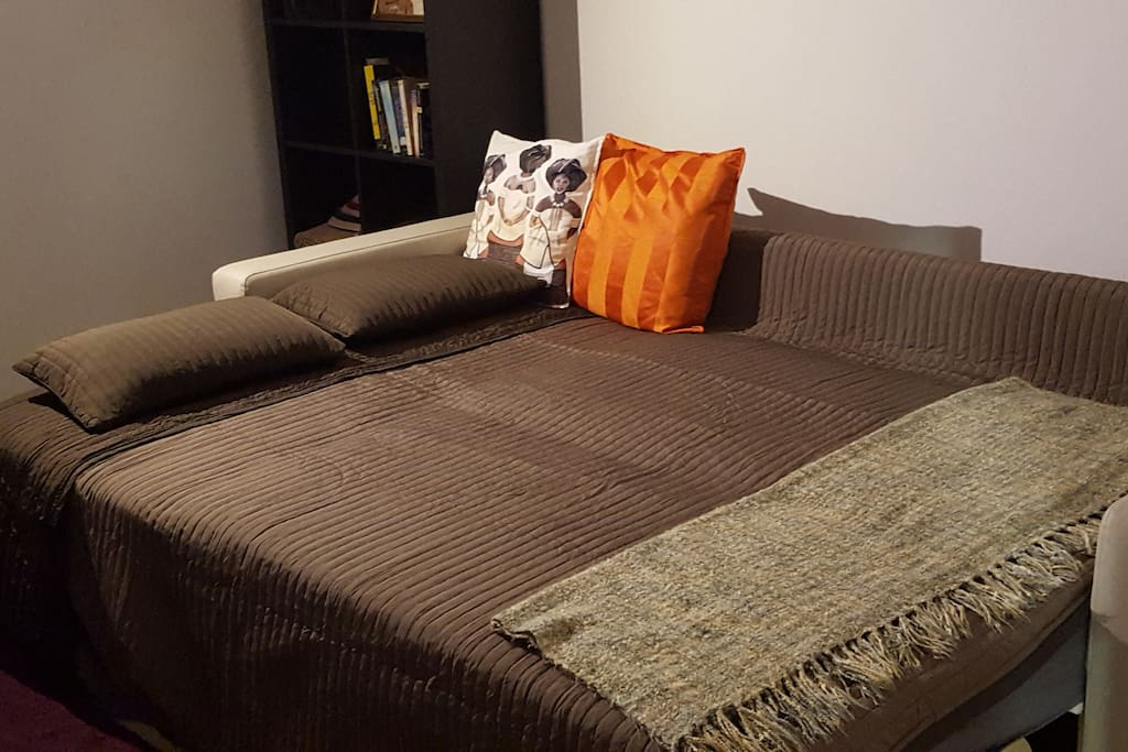 The Apartment:  The sofa bed opens into a double bed comfortable for two.