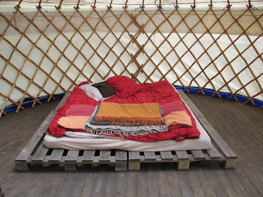 The bed in the yurt can be transformed also into two separate beds or a double bed like here. Additional mattresses for extra people are possible if you have kids or like to stay here with a group of people.