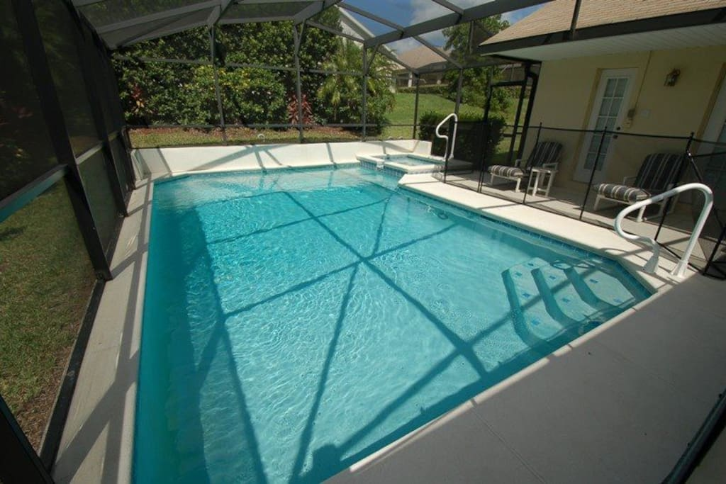 Relax and make hundreds of happy family memories together in and around this sparkling pool and sun-drenched pool deck at your Orange Tree vacation