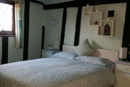 Two comfortable rooms avaliable in beamed cottage.  Shared facilities with owner and two small dogs . Cottage located in centre of historical  village. Several pubs, shops and local transport all within walking distance. Local beach within 2 miles.