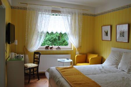 Doppelzimmer ALEXiS mit Gartenblick - Haus