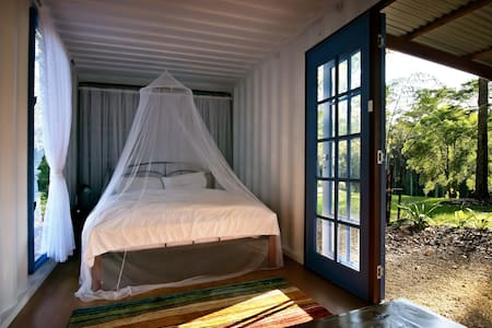 The Cream Cabin is a comfortable converted shipping container. It shares an undercover kitchen and stylish bathroom with the Green Cabin, all set in beautiful park like gardens. Cabins can be booked together for a lesser fee - see separate listing.