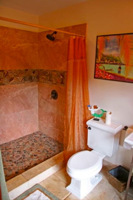 Beautiful marble and travertine bathroom.