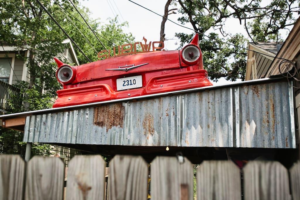 Rear end of a 59 Ford Fairlaine on the roof of my car port.  Keep Austin Weird!!!!