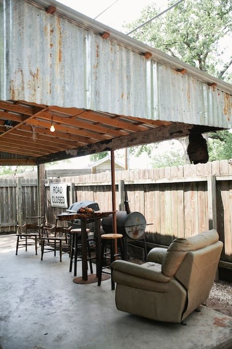 Plenty of outdoor hang out space under the car port.