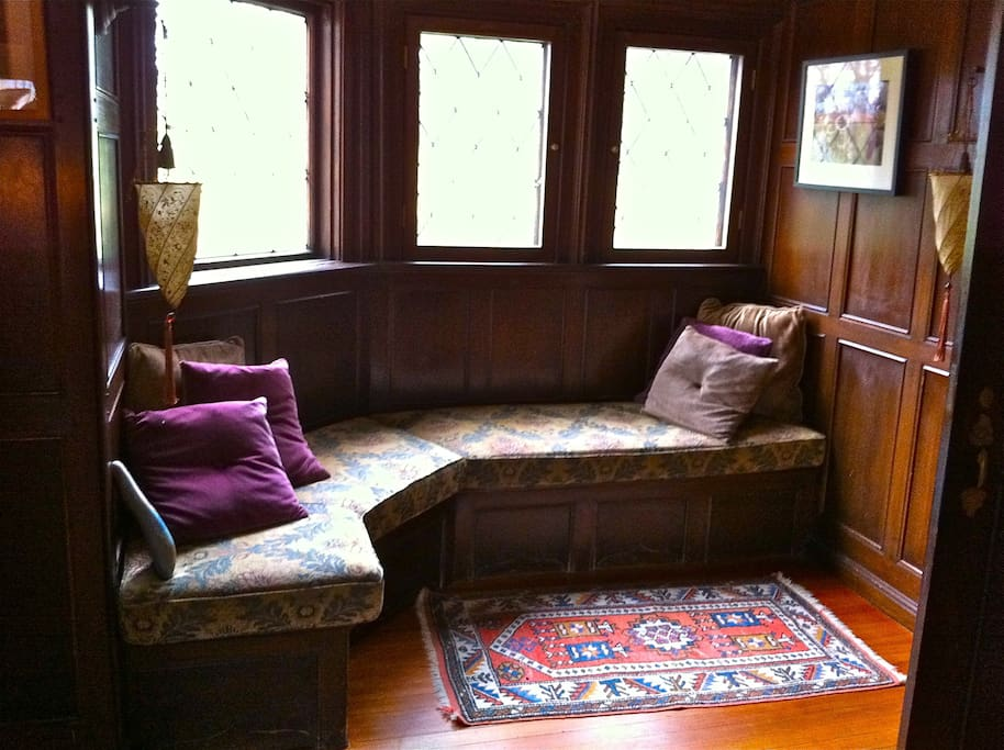 Window seat in the entrance to this 1905 home