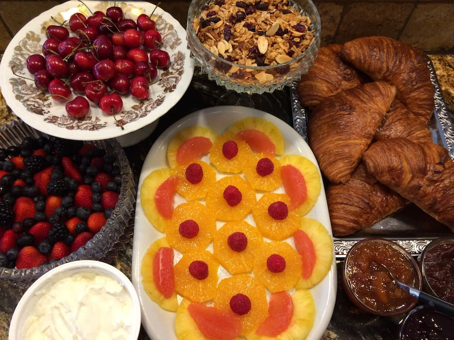 Cardinals Inn Spring Continental Breakfast; fresh baked butter croissants, fresh berries, citrus assortment, local toasted granola, Greek yogurt, home-grown organic apple butter, cantaloupe and berry jam.