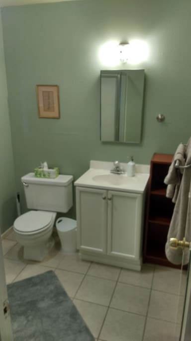 Bathroom is full size, with a standing shower (no bath tub). Stocked with toiletries and linens.