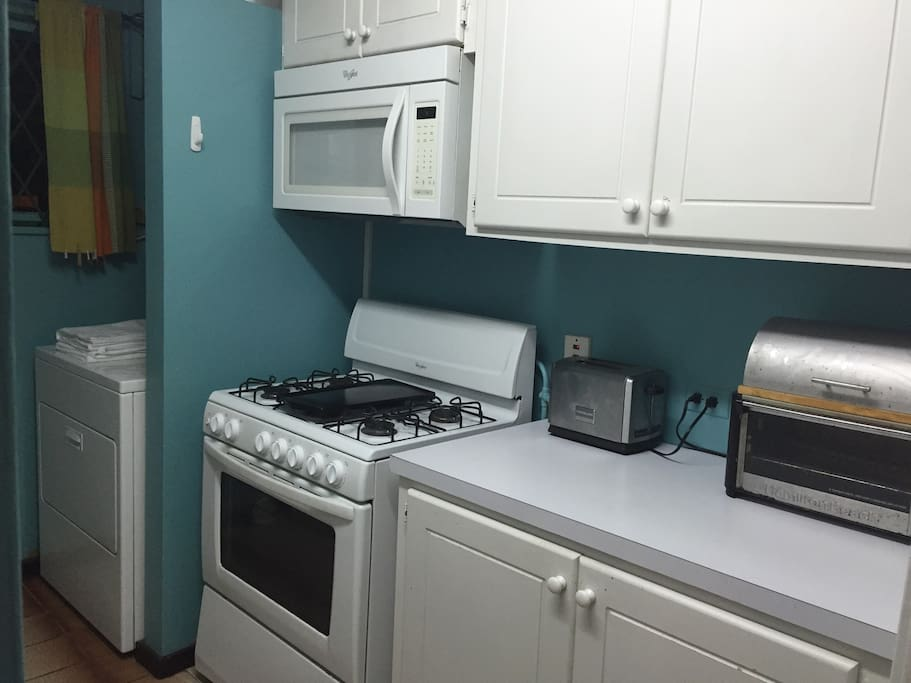 Gas stove and oven, microwave, toaster and toaster oven. Your all set for any kind of cooking!