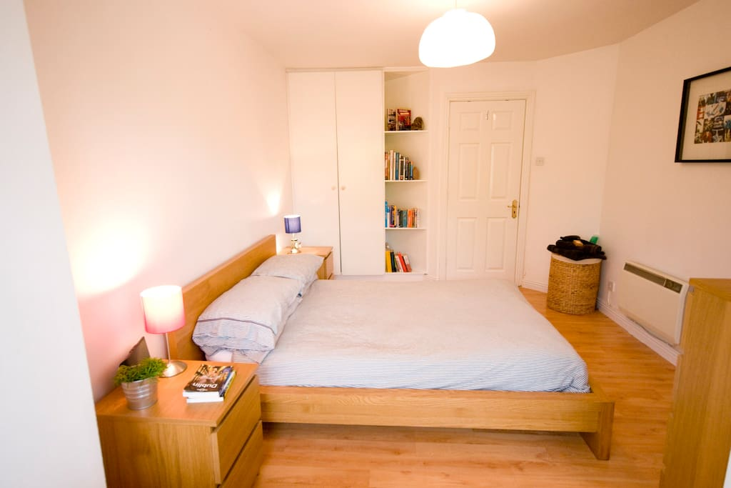 Spacious Bedroom with sofa in box window with views of nearby mountain