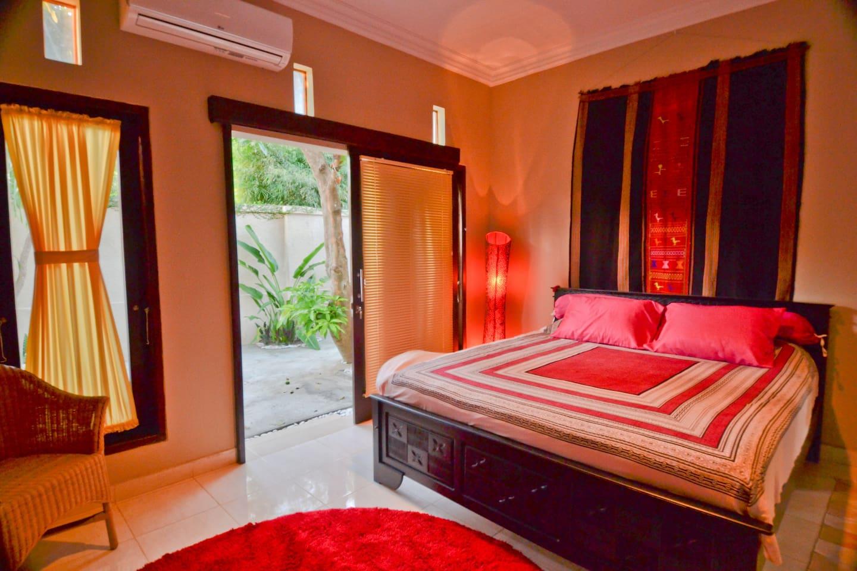 Master bedroom has a garden view.