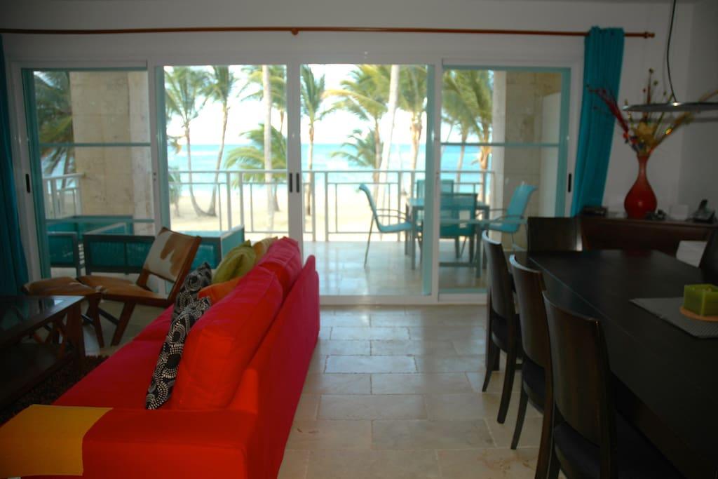 Living Room on left, dining room on right. Terrace,beach & ocean straight ahead!