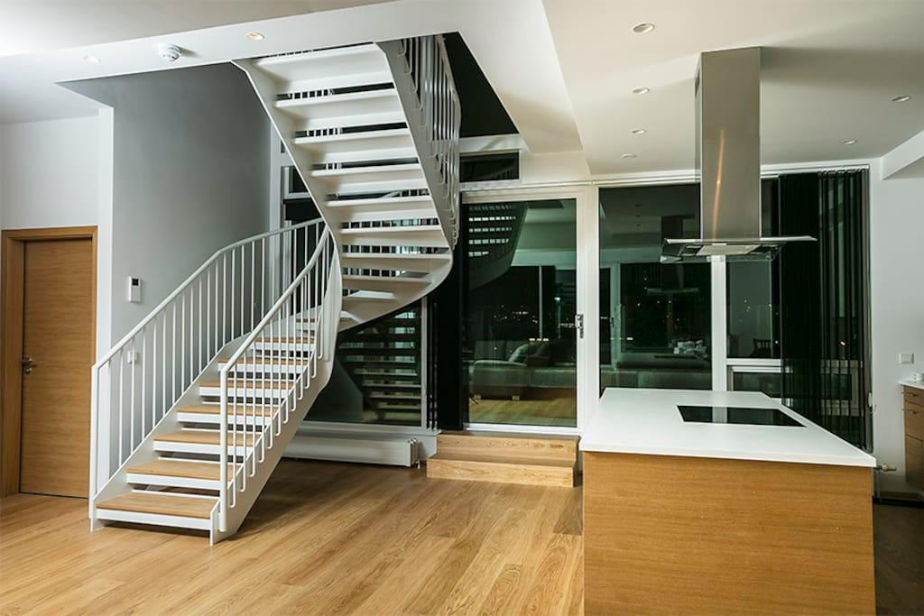 Stairs up on the top floor towards the bedrooms